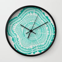 tree rings Wall Clocks featuring Turquoise Tree Rings by Cat Coquillette