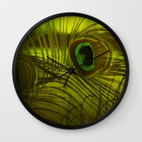 peacock feather Wall Clocks featuring Peacock Feather by TaLins