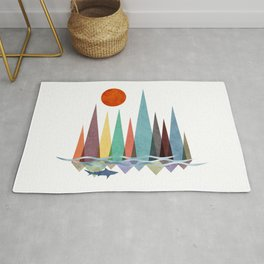 Minimal landscape design with colorful mountains and a shark swimming at sunset Rug