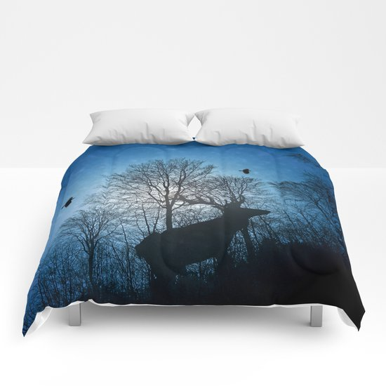 Deer in the snow Comforters