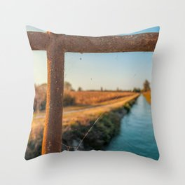 Bridge over an irrigation channel of the Lomellina at sunset Throw Pillow