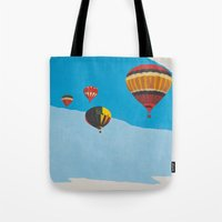 hot air balloons Tote Bags featuring Four Hot Air Balloons by Shelley Chandelier