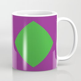 This is a Mask in a black background, with two emerald eyes looking at you in a creepy way. Coffee Mug