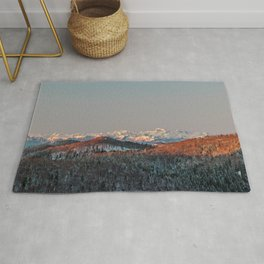 Sunset at spruce forest and mountains. Rug