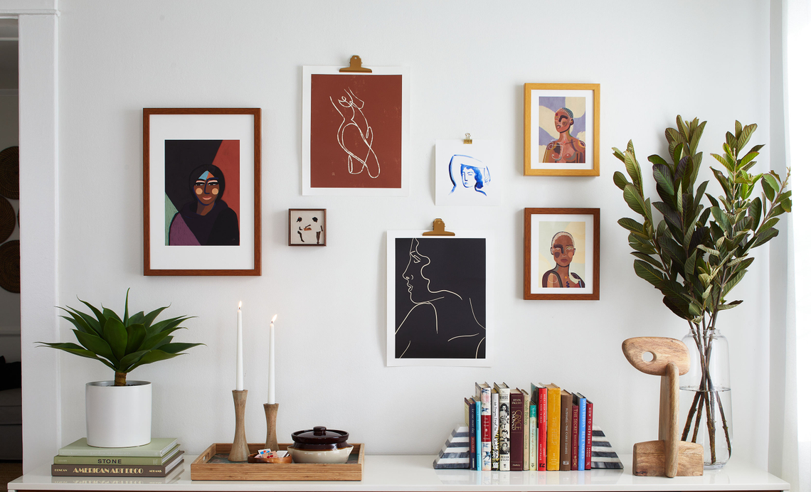 framed gallery wall above a credenza