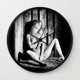 Very beautiful nude woman lying in the hay in black and white Wall Clock