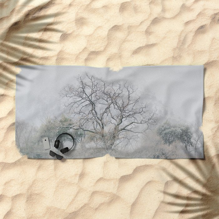 """King of the Mountain"". Foggy and snowy mountain. Beach Towel"