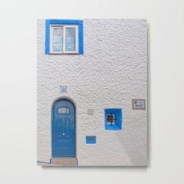 Blue door in Sitges Metal Print