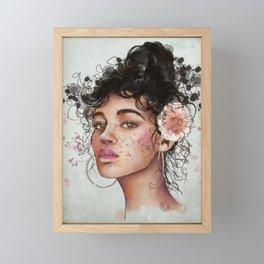 Woman's portrait with flower in her hair Framed Mini Art Print