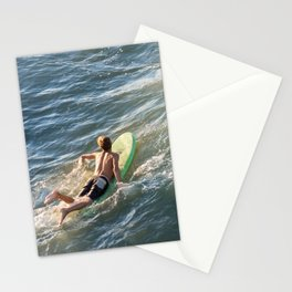 Surfer paddles out on surfboard without a wetsuit Stationery Cards