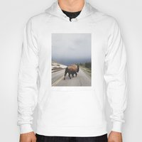 bison Hoodies featuring Street Walker by Kevin Russ