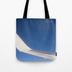 Airplane Wingtip on a blue sky Tote Bag