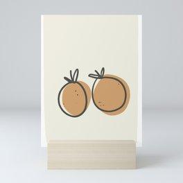 Cup of orange Mini Art Print