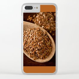Brown flax seeds portion on wooden spoon Clear iPhone Case