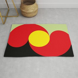 This is a sun splitting the sky in two sides, one black, one green. Spitting deep red round rays. Rug