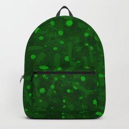 Splashes of light green paint. Backpack
