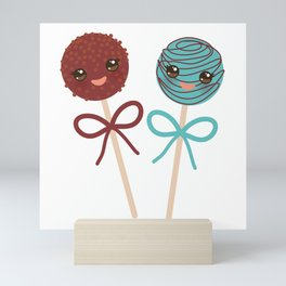cute funny kawaii chocolate and blue Sweet Cake pops set with bow on white background Mini Art Print