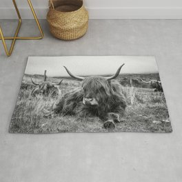 Highland Cow Sitting in a Field With Friends  Rug