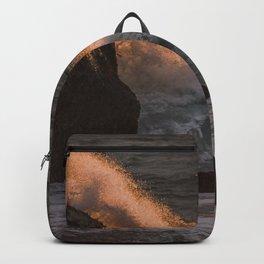 Golden Wave crashing on a rock Backpack