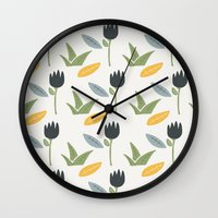 floral pattern Wall Clocks featuring Floral Pattern by Mark Conlan