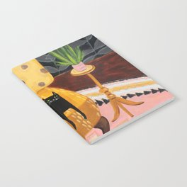 black cat on mustard yellow sofa painting by Tascha Notebook