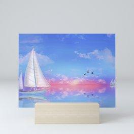 Sailboat towards sunset Mini Art Print