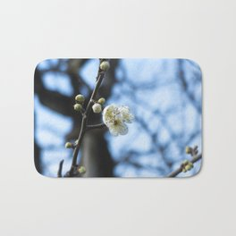 White plum blossoms and buds Bath Mat