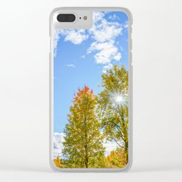 Autumn landscape: colorful trees, blue sky and the sun. Clear iPhone Case
