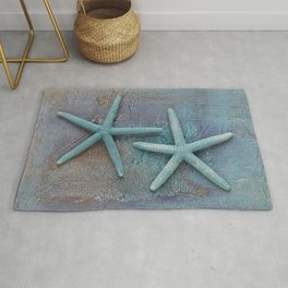 Turquoise Starfish on textured Background Rug