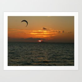 Sunset in the calm sea with red sky, gray cloud and a parachute Art Print