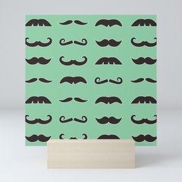 Vintage brown mustaches on seafoam green background Mini Art Print