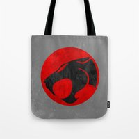 thundercats Tote Bags featuring Thundercats (Super Minimalist series) by Itomi Bhaa