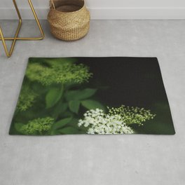 A bunch of lonesome flowers Rug