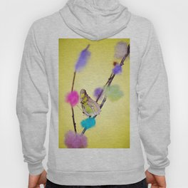 Tropical butterfly sitting on the colored bush over yellow background Hoody