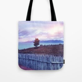 Sunset and lone tree Tote Bag