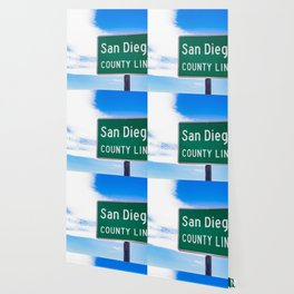 Closeup of the San Diego County Line Sign against a Blue Sky in the Anza Borrego Desert State Park Wallpaper