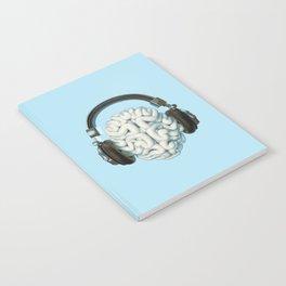 Mind Music Connection /3D render of human brain wearing headphones Notebook
