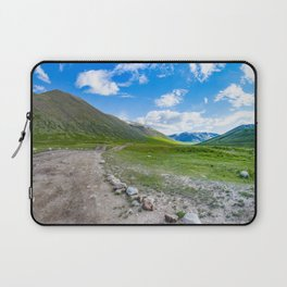 Alpine steppe in the background of snowy mountains. Altai Mountains, Russia. Laptop Sleeve