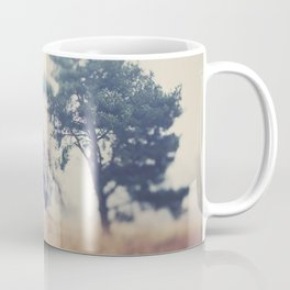 the story ... a tree & a field clouded in morning fog Coffee Mug