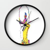 kardashian Wall Clocks featuring YELLOW KIM KARDASHIAN by The Draw Blurg
