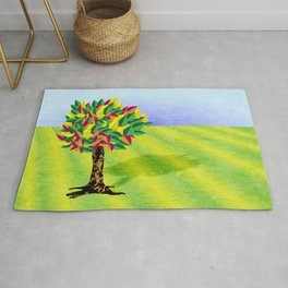 Autumn tree in a field Rug