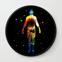 sagan Wall Clocks featuring The Universe is in Us by Ismael Sandiego