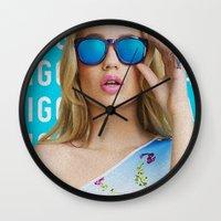 iggy azalea Wall Clocks featuring Iggy Azalea Blue by Illuminany