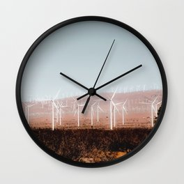 Wind turbine in the desert with blue sky at Kern County California USA Wall Clock