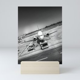 Airport plane artistic black and white photo refuelling for take off Mini Art Print