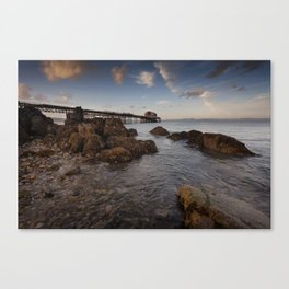 Rocky foreshore at Mumbles pier Canvas Print