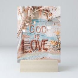 God is love salvation mountain Mini Art Print