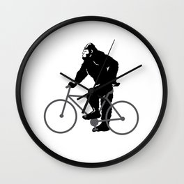 Bigfoot  riding bicycle Wall Clock