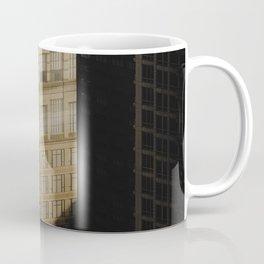 BROWN CONCRETE BUILDING DURING NIGHT TIME Coffee Mug
