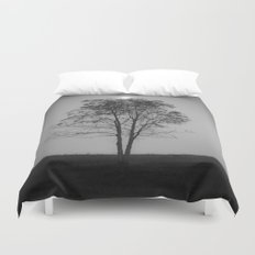 Moon over a tree Duvet Cover